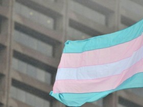 The transgender flag flying in front of Boston City Hall earlier this week. Today, May 12, the Massachusetts Senate votes on the public accommodations access bill. Photo courtesy Mass Trans Political Coalition