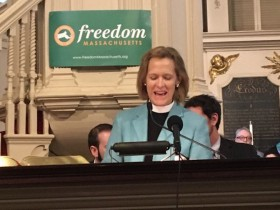 Reverend Joy K. Fallon, senior minister at King's Chapel, leading a gathering to support Massachusetts's recently passed transgender-equality law on October 13, 2016. Days after the law went into effect on October 1, an anti-transgender advocacy group presented enough signatures to ask voters for a repeal in 2018. Photo courtesy of Freedom Massachusetts.